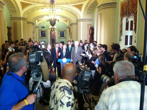 Senate GOP leaders addressing press corps after voting to raise the debt ceiling.