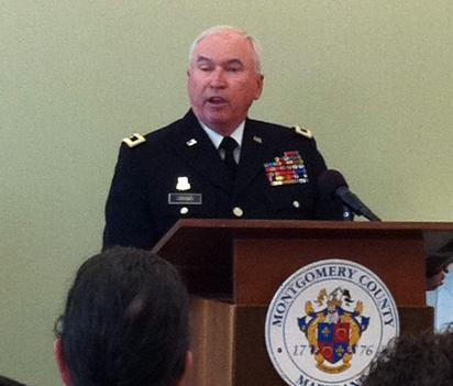 "Maryland Adjutant Gen. James Adkins speaks at the launch ceremony for Montgomery County's ""Serving Together"" program Aug. 1."