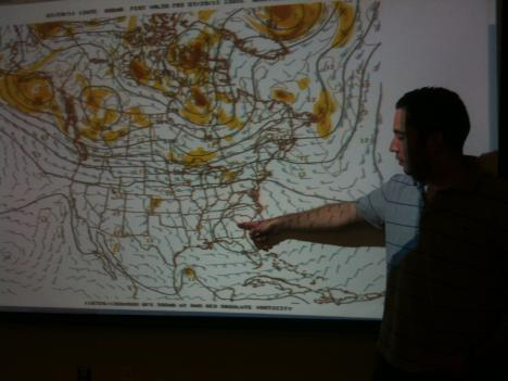 """Jerad Klein with the National Weather Service points to an area of high pressure that brought hot air from the south and the tropics... combined it with high humidity... and pinned it down over the southern central and southeast US to form a """"heat dome."""""""