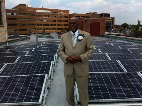 Dr. Earl Trent Jr., reverend at Florida Avenue Baptist Church, in front of the church's recently installed solar panels.