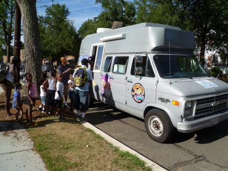 Customers line up to cool down at Uzman Leigh Jalloh's ice cream truck in Northeast D.C.