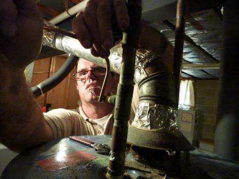Jackie Maloney has been an HVAC technician for 35 years. He says working in 100 degree heat is just part of the job.