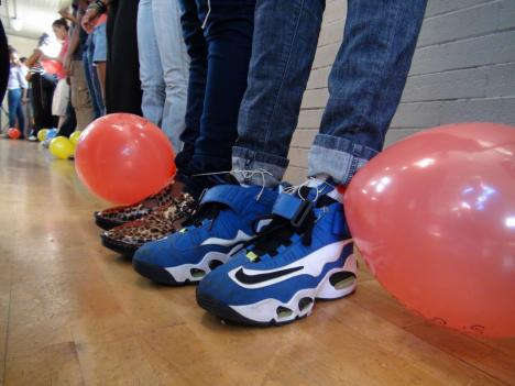 Teens were tied together in pairs with balloons attached as part of a team building exercise at Community Education Day.