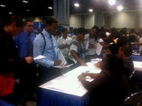 Job seekers promote themselves to potential employers at the annual summer job fair in D.C.