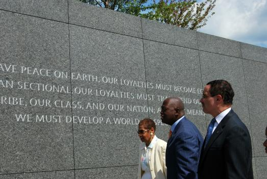 D.C. Delegate Eleanor Holmes Norton, left, Harry Johnson, president of the National Memorial Project Foundation, Inc., second from left,  and Mayor Vincent Gray look at the wall at the Martin Luther King Jr. Memorial on the National Mall.