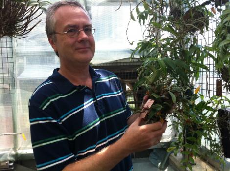 Wallick holds one of the CITES plants that he's helping to preserve at the botanical garden.