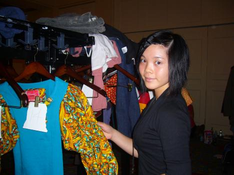 Jady Hwong, a junior at Woodrow Wilson High School, is one of about a dozen students who helped out backstage at the Fashion Fights Poverty Show at the Mayflower Hotel.