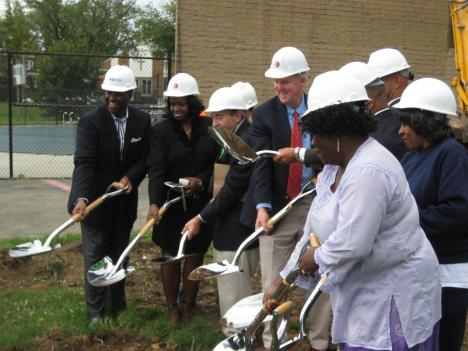 Government representatives and community members break ground on the Rosedale Community Center.
