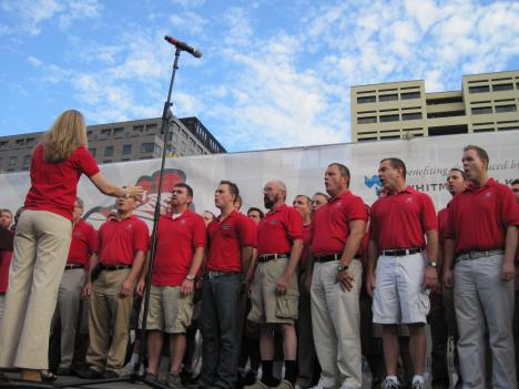 The Gay Men's Chorus of Washington sings the national anthem to kick off the walk.