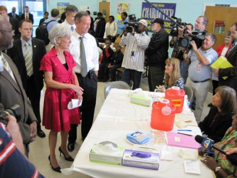 U.S. Health and Human Services Secretary Kathleen Sebelius, Maryland Gov. Martin O'Malley and U.S. Education Secretary Arne Duncan greet some of the nurses giving out H1N1 vaccinations.