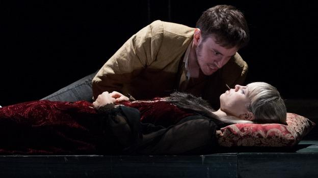A heart-broken Romeo (Michael Goldsmith) bids farewell to Juliet (Erin Weaver) in the Capulet tomb.