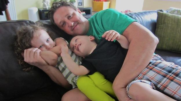 Stay-at-home dad Adrian Kulp with his two children.