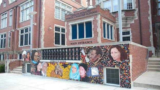 A mural is painted on the front wall of Carlos Rosario International Public Charter School in northwest Washington, D.C.