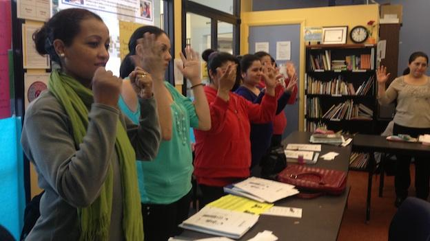 "Students in a health class at St. Mary's Center in northwest D.C. are learning different body parts. They are signing ""hands."""