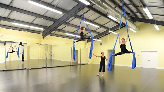 Students at Washington & Lee practice aerial dancing at a campus facility.