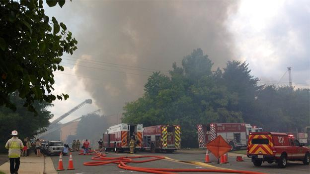 The six-alarm fire raged for hours and left four fighters with minor injuries.