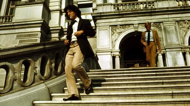 Carl Bernstein (Dustin Hoffman) and Bob Woodward (Robert Redford) leave the Library of Congress after researching information on the Watergate burglars in All the President's Men.