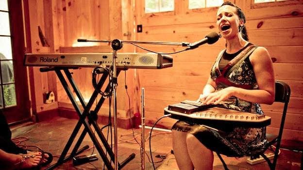 Singer-songwriter Angela Sheik uses a loop pedal, a theremin, and a flute to create her unusual sound.