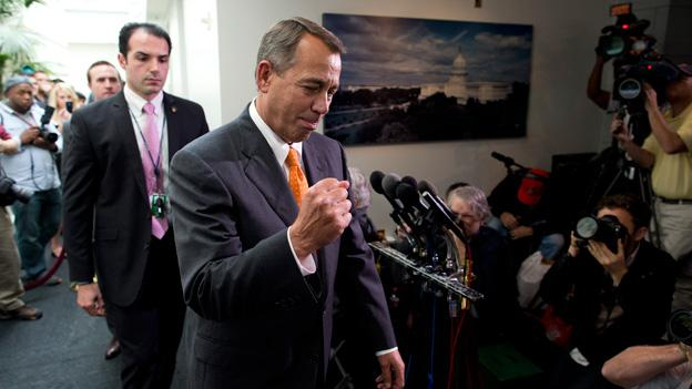 Speaker of the House Rep. John Boehner, R-Ohio, pumps his fist as he walks past reporters after a meeting with House Republicans on Capitol Hill on Wednesday, Oct. 16, 2013 in Washington. The partial government shutdown is in its third week and less than two days before the Treasury Department says it will be unable to borrow and will rely on a cash cushion to pay the country's bills.