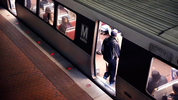 A rider enters a Metro train in the Gallery Place-Chinatown Metro station Tuesday, March 15, 2016 in Washington. The system was shut down Wednesday so the transit agency could conduct inspections.