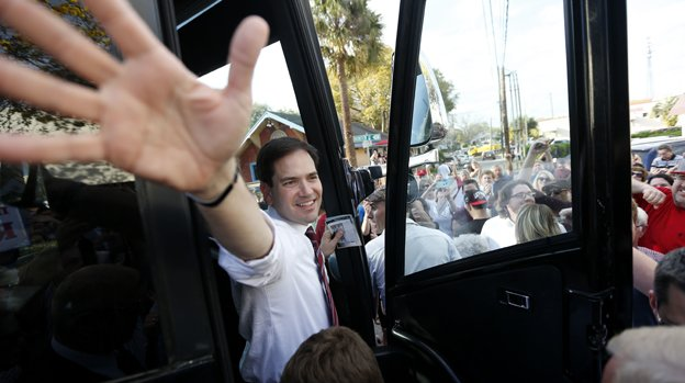 Republican presidential candidate, Sen. Marco Rubio, R-Fla., waves as he boards his bus after a campaign stop in Lakeland, Fla., Saturday, March 12, 2016. Rubio took the majority of the delegates in D.C.