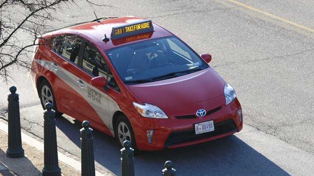 A Washington, D.C. taxi drives along Constitution Avenue in the nation's capital, Monday, March 24, 2014.