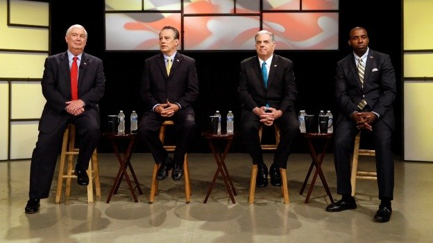Republican gubernatorial candidates David Craig, from left, Ron George, Larry Hogan and Charles Lollar wait for a Republican gubernatorial primary debate to begin at Maryland Public Television's studios in Owings Mills, Md., Monday, June 2, 2014.