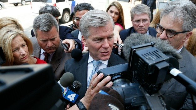 Former Virginia Gov. Bob McDonnell, center, answers reporters questions as he leaves the 4th U.S. Circuit Court of Appeals after a hearing on the appeal of his corruption conviction in Richmond, Va., Tuesday, May 12, 2015.