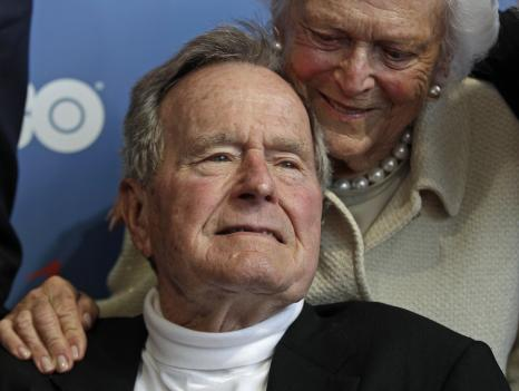 "In this June 12, 2012 file photo, former President George H.W. Bush and his wife, Barbara, arrive for the premiere of HBO's new documentary about his life in Kennebunkport, Maine. On Wednesday, a spokesman for the former president says the 88-year-old is alert and talking to medical staff after being admitted to the intensive care unit at a Houston hospital. Bush has been hospitalized since Nov. 23, when he was admitted for a lingering cough related to bronchitis and ""remains in guarded condition."""
