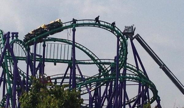 This image provided by Prince George's County Fire Dept. shows firefighters reaching riders stranded on a roller coaster at Six Flags America in Upper Marlboro, Md., Sunday, Aug. 10, 2014.