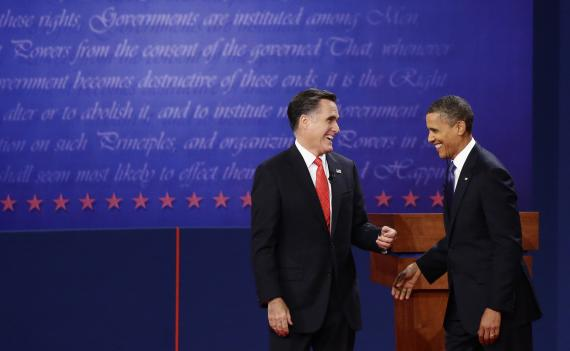 President Barack Obama and Republican presidential candidate and former Massachusetts Gov. Mitt Romney talk at the end of the first presidential debate in Denver, Wednesday, Oct. 3.