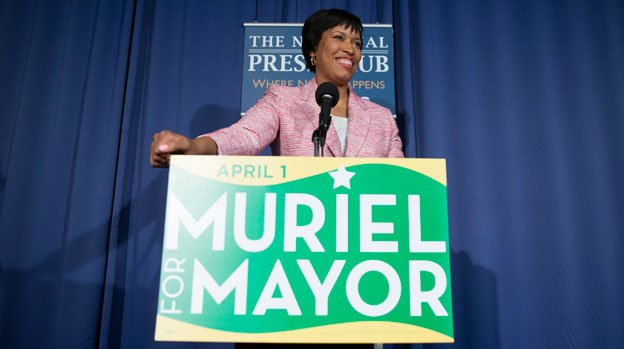 Washington Democratic Mayoral nominee Muriel Bowser smiles as she discusses the election day primary victory during a news conference at the National Press Club, on Wednesday, April 2, 2014, in Washington.