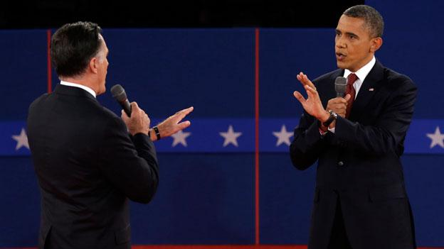 Republican presidential nominee Mitt Romney and President Barack Obama spar over energy policy during the second presidential debate at Hofstra University, Tuesday, Oct. 16, 2012, in Hempstead, N.Y.