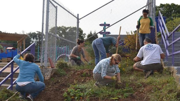 Staff and volunteers from the Washington Youth Garden work at Mary McLeod Bethune Day Academy in Washington, D.C.