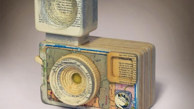 """Ching Ching Cheng's """"Argus"""" demonstrates how the artist uses bits of books to sculpt paper cameras."""