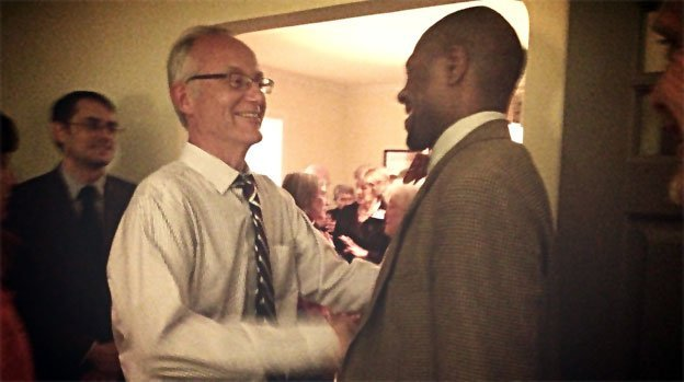 Arlington County Board Member-elect John Vihstadt, left, greeted supporters during his victory party Tuesday night.