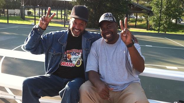 Austin Carmichael (a.k.a. Rick Brown, right) with a friend on Barry Farm's basketball courts.