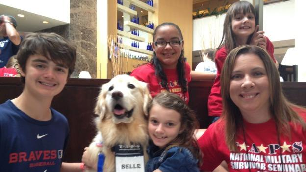 Belle is one of the many therapy dogs that helps comfort the families of the fallen.