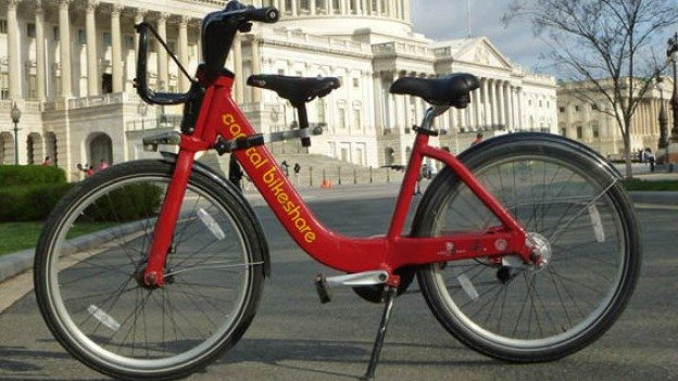 The kid's bike seat attaches to the downtube of Capital Bikeshare's hefty red bikes.