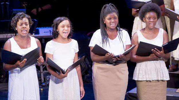 "From left to right, Saran Bakari, Naila Kenya, Mariama Sonko, Victoria Jones sing in ""Four Little Girls, Birmingham 1963"" in the Family Theater."