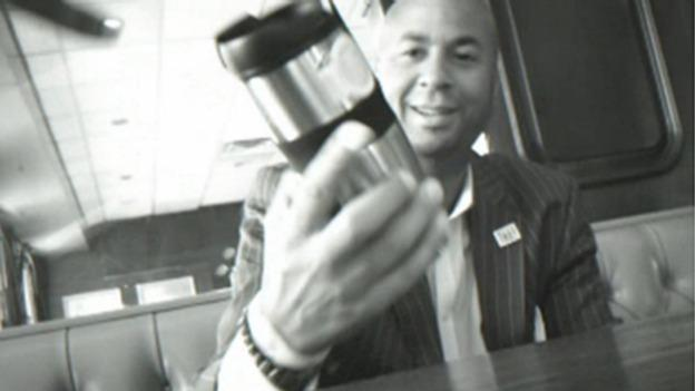 In this image produced from a hidden camera, Brown was given cash bribes amounting to $5,000 concealed inside a mug.