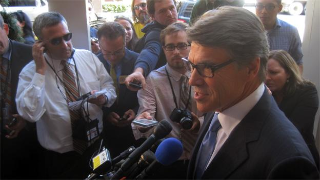 Rick Perry spoke to reporters outside Morton's in the Hyatt Regency Hotel.