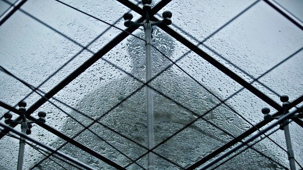Heavy wet snow settles on a skylight obscuring the outline of the Capitol Dome in Washington, Wednesday, March 6, 2013.