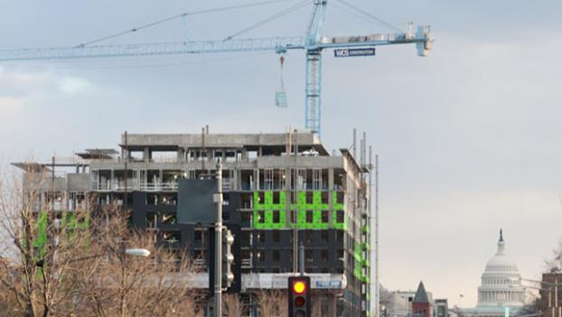 D.C.'s real estate market is booming, as evidenced by cranes like this one in the NoMa neighborhood.  The building in this photo is not related to this investigation. (WAMU Photo by Jared Angle)