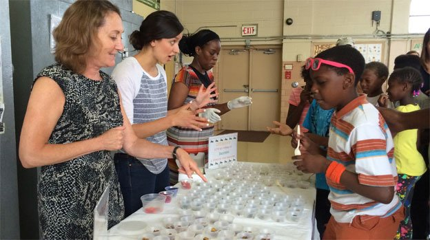 Professor Stacey Snelling and Katie Nash of the D.C. Central Kitchen conduct taste tastes with students at Aiton Elementary School.