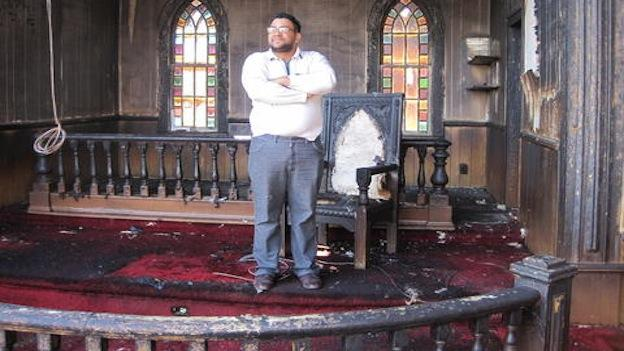 Rev. Carl Perez standing in the 135-year-old Adams United Methodist Church in Whitesville, Va.