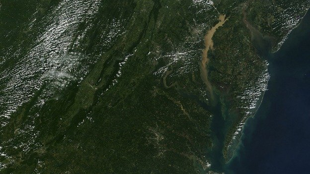 This image from NASA shows sediment runoff into the Chesapeake Bay in the wake of a tropical storm in September 2011.
