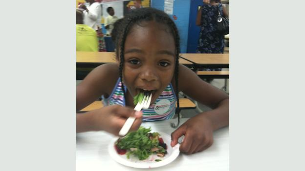 A Beers Elementary School student enjoys a snack on Salad and Strawberry Day.