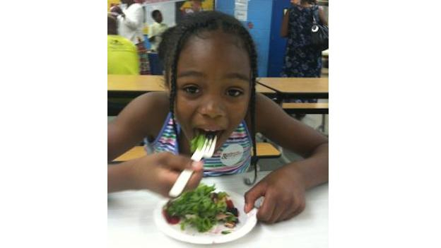 A Beers Elementary School student enjoys a snack on 'Salad and Strawberry Day.'