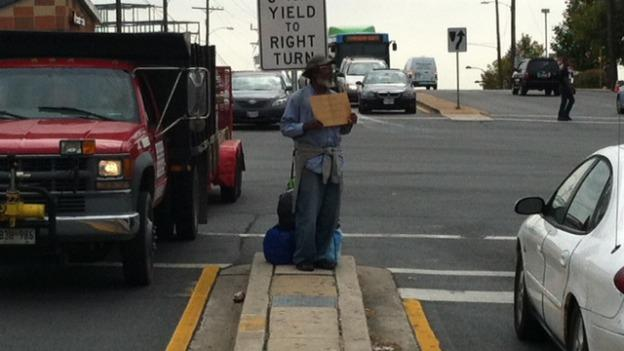 Clarence panhandles at the intersection of Viers Mill Road and University Boulevard in Wheaton, Md.